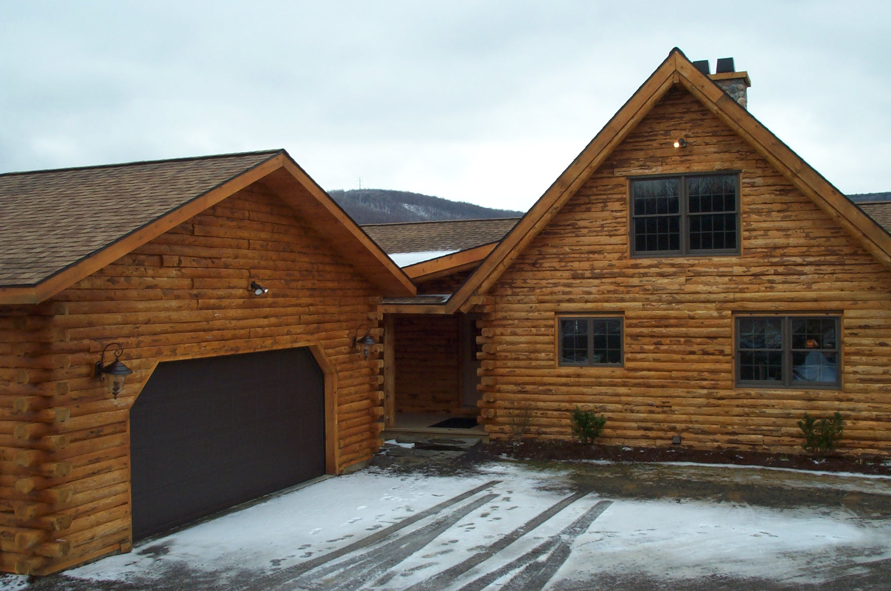 Log home with garages garage best free home design for Log cabin house plans with garage