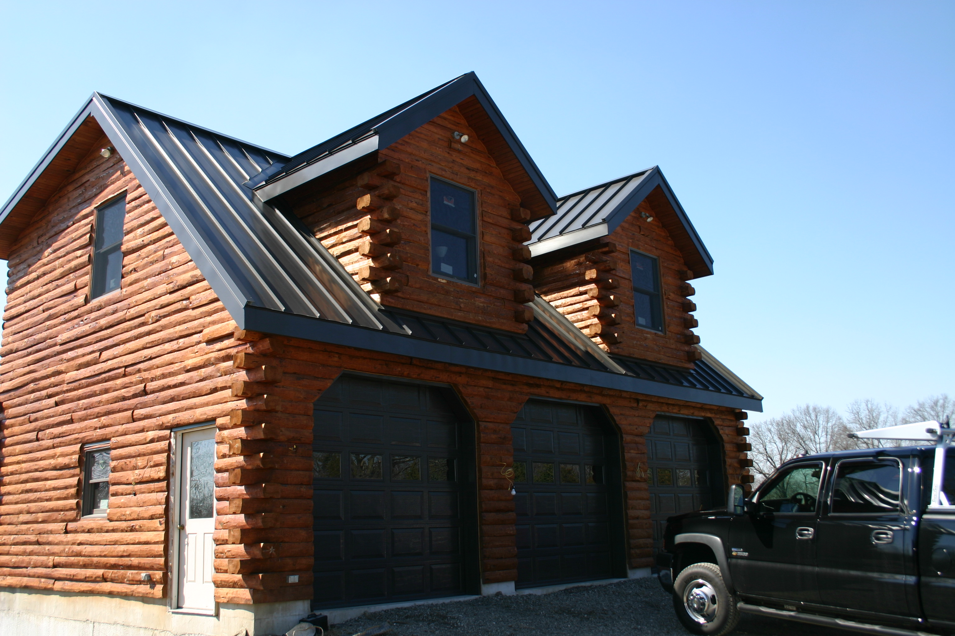 Log home with garages garage log homes with walkout for Log home garages